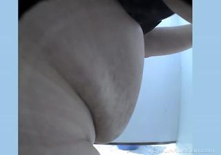 russian older voyeur/hidden camera in beach cabin