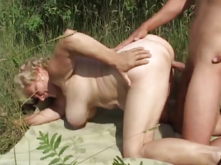 german old outside with inexperienced man by troc